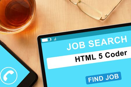 coder: Tablet with HTML 5 Coder on job search site.