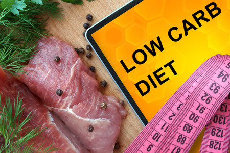 Tablet with low carb diet and fresh meat 스톡 콘텐츠
