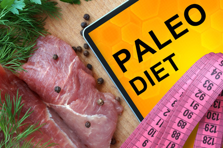 carb: Tablet with Paleo diet and Fresh Meat Stock Photo