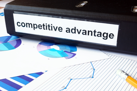 privilege: Graphs and file folder with label competitive advantage.