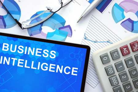 investigate: Tablet with business intelligence , graphs and calculator. Stock Photo