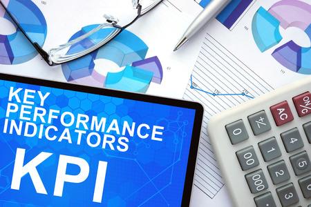 kpi: Tablet with Key Performance Indicators  , KPI , graphs and calculator. Stock Photo