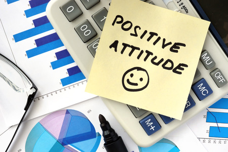 Papers with graphs and words positive attitude photo