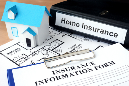home insurance: Model of house and folder with home insurance. Business  concept