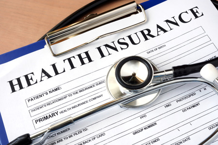 medical personal: Health insurance form with stethoscope. insurance concept