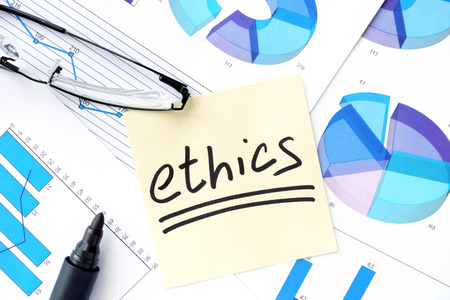 rightful: Papers with graphs, glasses and ethics business  concept. Stock Photo