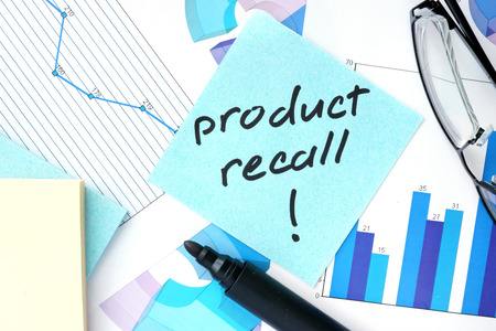 recall: Papers with graphs, glasses and Product Recall concept.