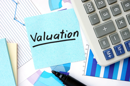 valuation: Papers with graphs, calculator and Valuation concept.