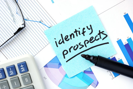 identify: Papers with graphs, glasses and Identify Prospects concept.