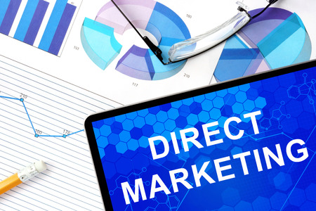 direct marketing: Tablet with  direct marketing, graphs and glasses. Stock Photo
