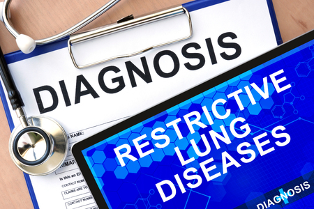 restrictive: Form with word diagnosis and tablet with Restrictive lung diseases