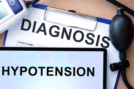 hypotension: Tablet with hypotension and form with word diagnosis Stock Photo