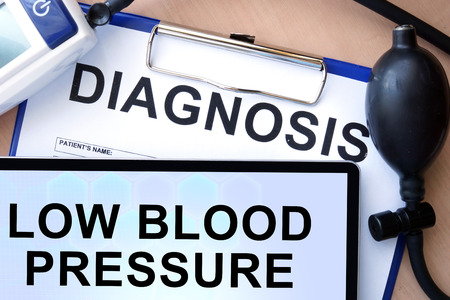 systole: Tablet with low blood pressure and form with word diagnosis Stock Photo