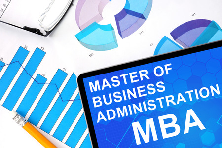 mba: Tablet with word MBA Master of Business Administration and graphs. Concept photo.