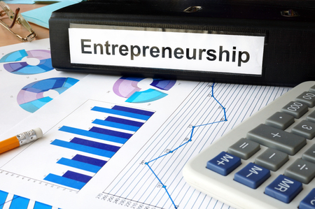 entrepreneurial: Folder with the label entrepreneurship and charts