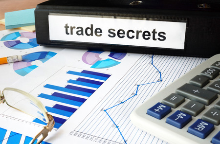 trade secret: Folder with the label trade secrets and charts Stock Photo