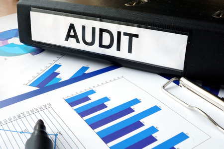 financial audit: Folder with the label AUDIT and charts Stock Photo