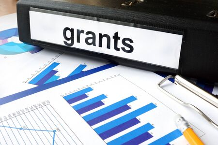financial education: Folder with the label grants and charts