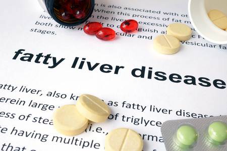 hepatic: Paper with fatty liver disease and pills.