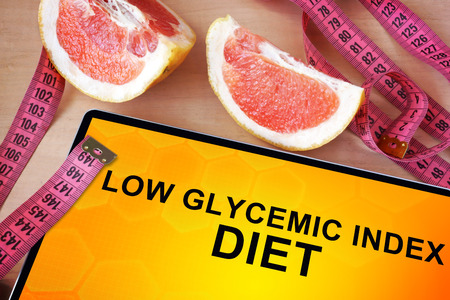 glycemic: Tablet with low glycemic index diet and grapefruit Stock Photo