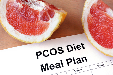 Paper with PCOS diet Meal plan and grapefruit Stock Photo