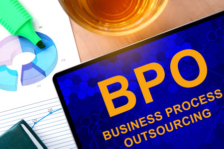 outsourcing: Words Business Process Outsourcing BPO on the tablet and charts.