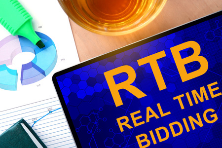 bidding: Words Real Time Bidding RTB on the tablet and charts.