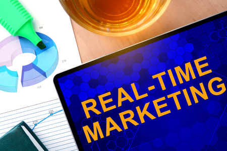 realtime: Words RealTime Marketing on the tablet and charts.