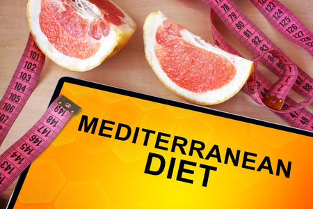 Tablet with Mediterranean diet. Weight loss concept. photo