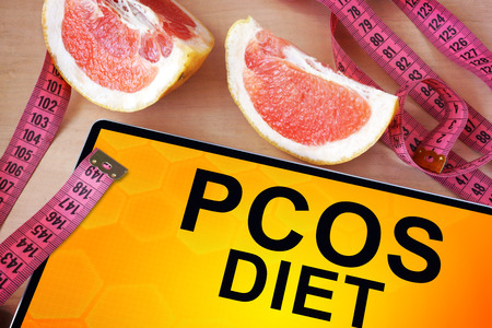 Tablet with PCOS diet. Weight loss concept. photo
