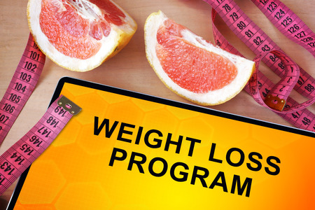 loss weight: Tablet with weight loss program. Weight loss concept. Stock Photo