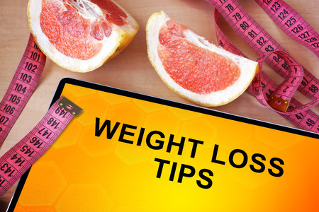 WEIGHT: Tablet with weight loss tips. Weight loss concept.