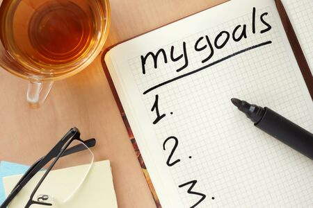 setting goals: Notepad with words my goals concept. Stock Photo
