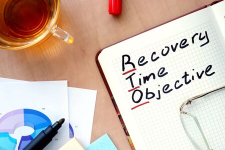 contingency: Notepad with word RTO recovery time objective concept and marker.