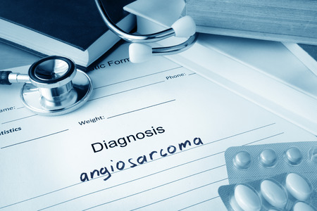 neoplasm: Diagnostic form with diagnosis angiosarcoma and pills.