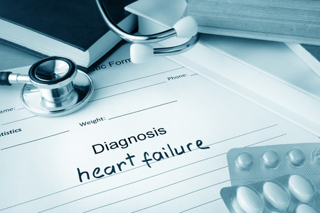 failure: Diagnostic form with diagnosis heart failure and pills.