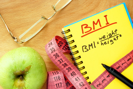 bmi: BMI body mass index formula in a notepad. Stock Photo