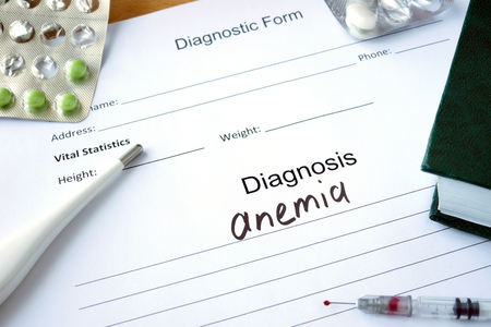 anemia: Diagnostic form with Diagnosis anemia and pills.