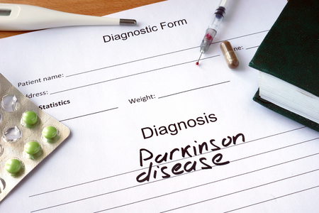 degenerative: Diagnostic form with Diagnosis Parkinson disease and pills.