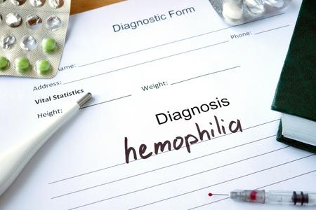 hemophilia: Diagnostic form with Diagnosis hemophilia and pills.