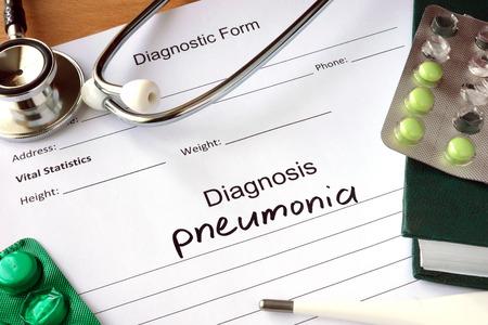 pneumonia: Diagnostic form with Diagnosis pneumonia and pills.