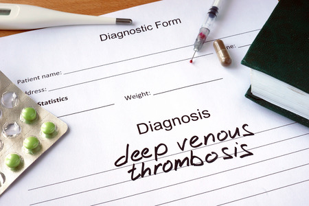 Diagnostic form with Diagnosis deep venous thrombosis and pills. Archivio Fotografico