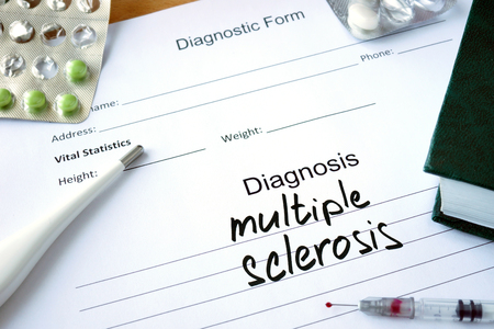 sclerosis: Diagnostic form with Diagnosis multiple sclerosis and pills.