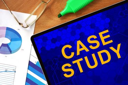 case: Tablet with Case Study and charts on a wooden board.