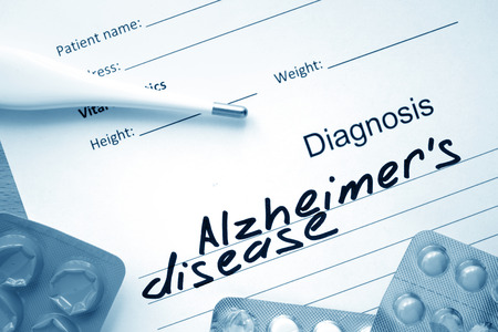 alzheimers: Diagnostic form with diagnosis Alzheimers disease and pills.
