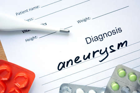 aneurism: Diagnostic form with diagnosis Aneurysm and pills.