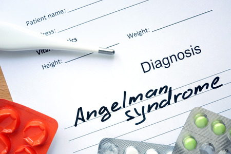 seizures: Diagnostic form with diagnosis Angelman syndrome and pills. Stock Photo