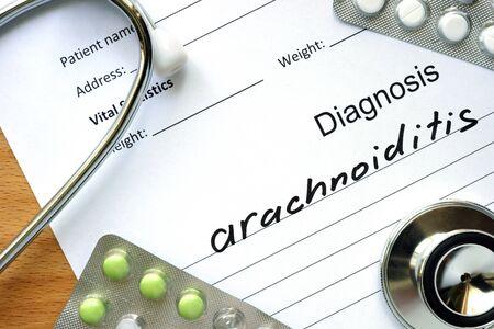 arachnoid: Diagnostic form with diagnosis Arachnoiditis and pills. Stock Photo