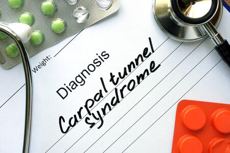 carpal tunnel syndrome: Diagnosis Carpal tunnel syndrome and tablets. Stock Photo