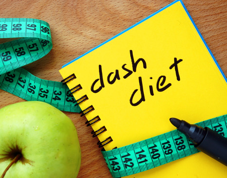 low fat diet: Notepad with dash diet apple and measure tape